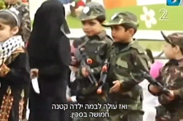 Palestinian children show how to stab a Jew